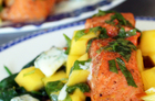 Salmon curry with chickpeas, mango salsa and mint yoghurt. Photo / Doug Sherring
