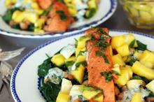 Salmon curry with chickpeas, mango salsa and mint yoghurt. Photo / Doug Sherring