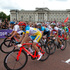 Competitors lead by New Zealand's Jack Bauer, who finished in 10th place, pass Buckingham Palace during the sprint to the finish of the Olympic Games Men's Road Race in the last 50m. Photo / Brett Phibbs