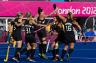 New Zealand Black Sticks celebrate their goal against Australia during the hockey pool match between New Zealand and Australia. Photo / Brett Phibbs