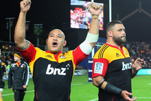 Sona Taumalolo of the Chiefs (L) celebrates their win after the Super Rugby Sem