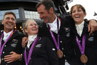 New Zealand's Andrew Nicholson, Jonelle Richards, Mark Todd and Caroline Powell after winning a Bronze medal in the Equestrian Eventing. Photo / Brett Phibbs.