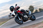 The 900R's height lets the rider see over the traffic, it's agile enough to dart around any obstacle and it's loud. Photo / Supplied