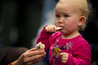 At 15 months, your first icecream should be a smile-making experience. Too bad Valerie Divnova's mum started her on liquorice at the Food Show yesterday. Picture / Sarah Ivey