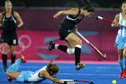 Kayla Sharland jumps over Argentina's Macarena Rodriguez Perez. Some passive play and sloppy finishing cost New Zealand the game. Picture / Brett Phibbs