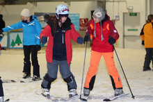 Snowplanet instructor Ashleigh (left) teaches Trang Dai basic ski moves. Photo / Doug Sherring