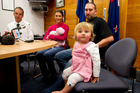 Alyssa Barker with parents Sam and Scott and baby sister Kashine at a police press conference yesterday. Photo /  Dean Purcell