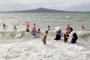 Many brave souls jumped into the sea yesterday at the Pirates of the Caribbean-themed Winter Splash at Mission Bay in Auckland.  Photo / Richard Robinson