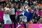 Carmelo Anthony pushes over France's Tony Parker. Photo / Brett Phibbs.