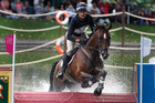 New Zealand's Mark Todd riding Campino taking on the water jumps during the individual eventing cross country at Greenwich Park Equestrian Centre in London. Photo / AP.