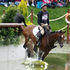 New Zealand's Mark Todd riding Campino taking on the water jumps during the individual eventing cross country. Photo / AP.