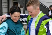 Lisa Allpress shows Matt Cameron her premiership trophy. Photo / Otago Daily Times