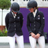 Jonelle Richards, left, receives a quick tip on how to curtsey correctly from fellow NZ Olympic Games eventing team Caroline Powell. Photo / Brett Phibbs.