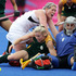 New Zealand Black Sticks Katie Glynn in a pile up with South Africa's Bernadette Coston and Mariette Rix. Photo / Brett Phibbs.