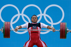 Triyatno Triyatno of Indonesia competes during the men's 69-kg, group A, weightlifting competition. Photo / AP.