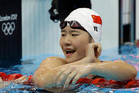 China's Ye Shiwen reacts after winning gold in the women's 200-meter individual medley swimming final. Photo / AP