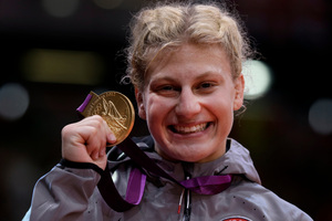 Kayla Harrison with her gold medal. Picture / AP