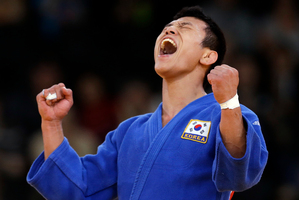 South Korea's Cho Jun-ho celebrates before the decision was reversed. Photo / AP.