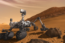 The Mars Science Laboratory Curiosity rover examines a rock on Mars. Photo / AP