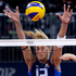 Italy's Valentina Arrighetti tries to block a shot during a women's preliminary volleyball match against Japan. Photo / AP.