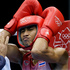Thailand's Chatchai Butdee adjusts his headgear before fighting Turkey's Selcuk Eker in a flyweight 52-kg preliminary boxing match. Photo / AP.