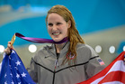 United States' Missy Franklin poses with her gold medal for the women's 100-meter backstroke swimming at the 2012 Olympics. Photo / AP