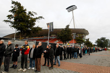 Thousands of rugby fans lined up outside the Waikato Stadium to buy tickets to this weekend's Super 15 rugby final match between the Chiefs and the Sharks. Photo / Christine Cornege