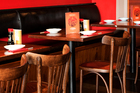 Red walls and plain wooden furniture grace Japanese restaurant Taisho. Photo / Babiche Martens