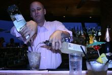 Joey Gottesman mixes up a mai tai. Photo / Jim Eagles