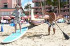 Jim Eagles (left) is taught paddle skills on Waikiki Beach. Photo / Jim Eagles