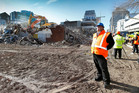 Earthquake Recovery Minister Gerry Brownlee watches Christchurch demolition work. Photo / Jarrod Booker