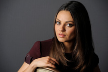 Mila Kunis' exotic looks mean she mirrors her role in Ted, in which her boss struggles to pinpoint her origins. Photo / Supplied