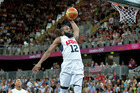 James Harden of the USA men's basketball team completes a dunk during their opening game at the London Olympics. Photo / Brett Phibbs