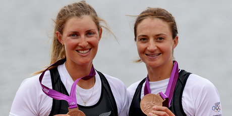 Rebecca Scown and Juliette Haigh are presented with their bronze medals. Source / Brett Phibbs NZ Herald