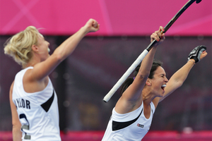 New Zealand Black Sticks players Kayla Sharland and Emily Naylor celebrate a goalduring their win over South Africa. Source / Brett Phibbs NZ Herald