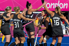 The Black Sticks celebrate Cathryn Finlayson's goal against Australia last night. Photo / Brett Phibbs