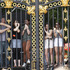 Fans cling to gates near Buckingham Palace to catch the action of the men's road race. Photo / Mark Mitchell