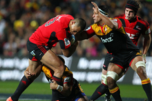 Robbie Fruean of the Crusaders looks to beat the tackle of Tanerau Latimer. Photo / Getty Images