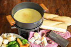 The fun comes when it's time to eat cheese fondue. Try a mixture of chopped vegetables and crusty bread. Get inventive with your dipping selections if you'd like. Photo / Michael Craig