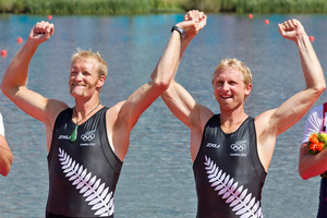 Eric Murray and Hamish Bond celebrate their gold medal on the podium at the London Olympics. Source / Brett Phibbs NZ Herald