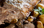 Roast goat leg with garlic and marjoram. Photo / Babiche Martens
