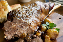 Roast goat leg with garlic and marjoram. Photo / Babiche Martens