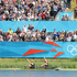 Hamish Bond and Eric Murray acknowledge the crowd after winning an Olympic gold medal. Source / Brett Phibbs NZ Herald