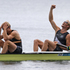 Hamish Murray and Eric Bond celebrate after winning a gold medal in the men's pair. Source / Brett Phibbs NZ Herald