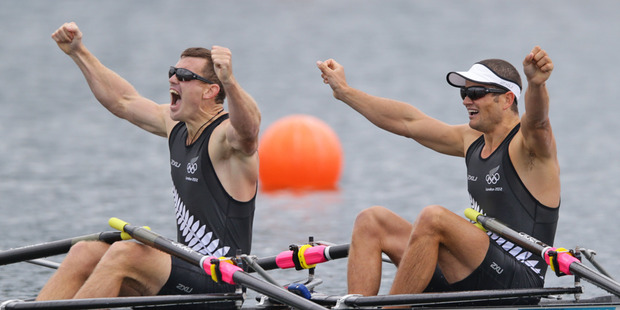Nathan Cohen and Joeseph Sullivan celebrate after crossing the line to win Olympic gold. Photo / Brett Phibbs