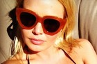 Lara Bingle showed off her Karen Walker sunglasses in a photo posted to her Twitter account. Photo / @MsLaraBingle