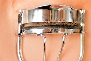 Simply using an eyelash curler before applying mascara will make your lashes look longer. Photo / Thinkstock