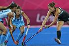 New Zealand Black Sticks player Krystal Forgesson in action against Argentina. Photo / Brett Phibbs