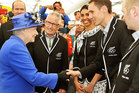 Queen Elizabeth II meets Kiwi athlete Nick Willis and other members of the New Zealand Olympic team as she tours the Athletes Village dining hall at Olympic Park in London. Photo / AP