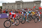 Competitors pass Buckingham Palace during the sprint to the finish of the Olympic Games Men's Road Race. Photo / Mark Mitchell